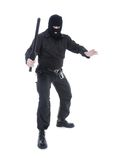 Special forces. Anti-terrorist police guy wearing black uniform and black mask holding firmly police club in one hand ready for action, shot on white Royalty Free Stock Image
