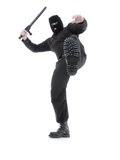 Special forces. Anti-terrorist police guy wearing black uniform and black mask making a kick, shot on white Stock Image