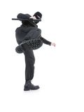 Special forces. Anti-terrorist police guy wearing black uniform and black mask making a side kick, shot on white Royalty Free Stock Images