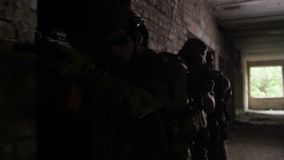 Anti-terrorist police during tactical exercises. Subdivision of anti-terrorist police during tactical exercises entering the premises. Group of soldiers carrying stock video