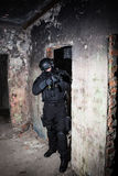 Anti-terrorist unit policeman/soldier. Special forces/anti-terrorist unit policeman or contractor during night CQB mission/operation (color toned image, very Stock Images