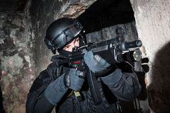 Anti-terrorist unit policeman/soldier. Special forces/anti-terrorist unit policeman or contractor during night CQB mission/operation (color toned image, very Royalty Free Stock Photos