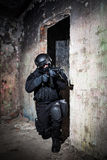 Anti-terrorist unit policeman/soldier. Special forces/ anti-terrorist police unit/private military contractor during night CQB hostage rescue raid/operation/ Stock Photography