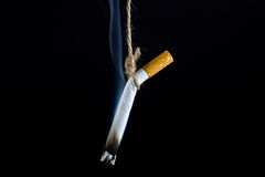 Anti Tobacco. Anti Tobacco, Cigarette was hanged with a rope on dark background stock photo