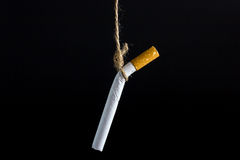 Anti Tobacco. Anti Tobacco, Cigarette was hanged with a rope on dark background stock photography