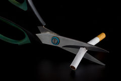 Anti Tobacco. Anti Tobacco, Cigarette were scissors cut off on dark background royalty free stock photography