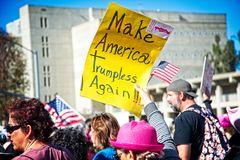 Anti-Trump messages at the 2018 Women`s March in Santa Ana. Santa Ana, California - January 20, 2018: Women holding an anti-Trump signs at the 2018 Women`s Royalty Free Stock Photo
