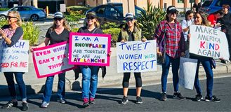 Anti-Trump messages at the 2018 Women`s March in Santa Ana. Santa Ana, California - January 20, 2018: Women holding an anti-Trump signs at the 2018 Women`s Royalty Free Stock Images