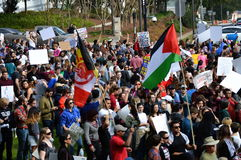Anti-Trump Protest Tallahassee, Florida. Crowd gathered in front of the Historic Capitol with flags and signs protesting the travel ban executive order Royalty Free Stock Images