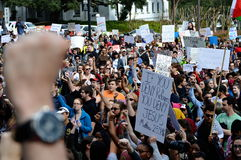 Anti-Trump Protest Tallahassee, Florida. People raising fists in solidarity against the travel ban executive order stock photos