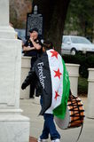 Anti-Trump Protest Tallahassee, Florida. Protester carrying drum with Syrian Flag tied around his neck Stock Images