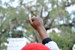 Anti-Trump Protest Tallahassee, Florida. Protester with fist raised in solidarity Stock Images