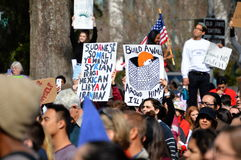 Anti-Trump Protest Tallahassee, Florida. Protesters holding signs, one with a misspelling, against the travel ban executive order Stock Photography