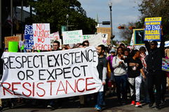 Anti-Trump Protest, Tallahassee, Florida. Protesters marching down Adams Street carrying banners and signs stock image