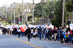 Anti-Trump Protest, Tallahassee, Florida. Protesters marching down Call Street with signs and flags on February 4, 2017 stock images