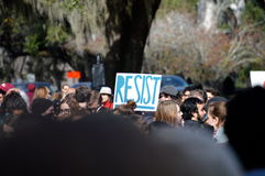 Anti-Trump Protest Tallahassee, Florida. Resist sign held up in the group of protesters Stock Image