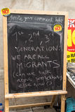 Anti UKIP message about immigration on blackboard. Anti UKIP and Farage message about immigration at a stall Stock Photography