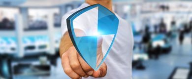 Anti virus shield protection. Businessman holding shield safe protection in his hand Royalty Free Stock Images