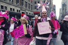 Anti-war `Code Pink` demonstrators taking part in the Easter Parade on 5th avenue in New York City. March 27, 2005 - New York, USA Royalty Free Stock Image