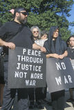 Anti-war protester in black. Marching at rally, Washington D.C Royalty Free Stock Image