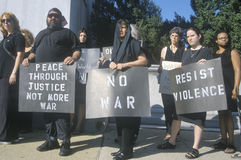 Anti-war protester in black marching at rally Stock Photo