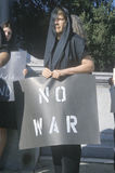 Anti-war protester in black marching at rally, Washington D.C. Royalty Free Stock Photos