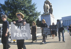Anti-war protester in black marching at rally, Washington D.C. Royalty Free Stock Photography