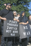 Anti-war protester in black marching at rally, Washington D.C. Stock Photos