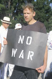 Anti-war protester in black marching at rally, Washington D.C. Stock Image