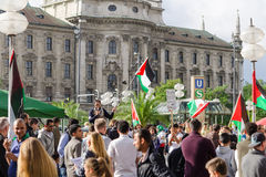Anti-war rally in support of the Palestinian people. MUNICH, GERMANY - AUGUST 16, 2014: Anti-war rally in support of the Palestinian people. Protesters are asked stock photography