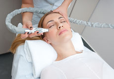 Anti wrinkles therapy. Attractive woman in beauty salon on face liting and anti wrinkles therapy royalty free stock photo