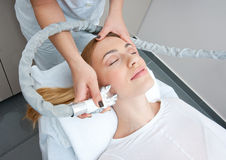 Anti wrinkles therapy. Attractive woman in beauty salon on face liting and anti wrinkles therapy stock photo