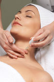 Anti-wrinkles treatment applying. Applying of anti-wrinkles treatment for neck skin in the beauty salon stock image