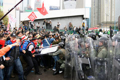 Anti-WTO Protests in Hong Kong. Protesters snatch the shield from police, finally they return the shield to police after cleaning Stock Image