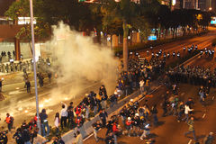 Anti-WTO Protests in Hong Kong. Police shooting tear bombs to protesters Stock Photos