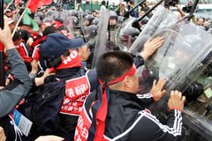 Anti-WTO Protests in Hong Kong. Protesters assault the cordon Stock Image