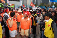Anti-WTO Protests in Hong Kong. Protesters prepare swim to the convention center Stock Photos