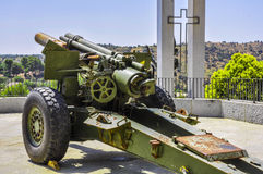 Antiaircraft gun with Christian Cross on the background. Horizontal view of an old antiaircraft gun with a Christian Cross on the back. Military museum in Toledo Royalty Free Stock Image