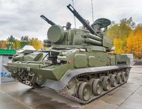 Antiaircraft missile system Tunguska M1. Russia. Nizhniy Tagil, Russia - September 26. 2013: Visitors examine military equipment on exhibition range Royalty Free Stock Photos
