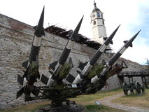 Antiaircraft rockets, clock tower in background. S125 Neva, launcher with antiaircraft rockets, Soviet surface-to-air missile sistem at Belgrade Military museum Stock Photo