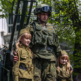 Antiaircrafter soldier and children in military uniform at the Immortal regiment on 9 May, 2016 in Ulyanovsk, Russia Royalty Free Stock Images