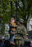 Antiaircrafter soldier holds a boy in military uniform at the Immortal regiment on 9 May, 2016 in Ulyanovsk, Russia Stock Photo