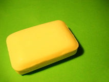 Antibacterial Soap. Bar of yellow antibacterial soap on a plain green background Stock Photos