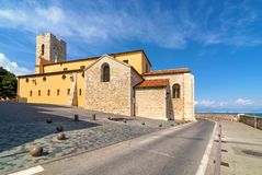 Antibes Cathedral and road along the sea in France stock photo