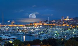 Antibes, French Riviera, Cote d Azur. Night full moon shot of Antibes and yachts on the French Riviera - cote d Azur royalty free stock photography