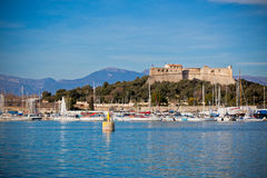 Antibes harbor, France, with yachts and Fort Carre Stock Photos