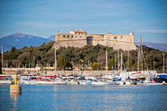 Antibes harbor, France, with yachts and Fort Carre Stock Images