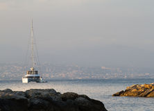 Antibes to Nice South of France. Panoramic view of cote d`azur coastline with sailboat Royalty Free Stock Photos