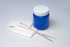 Antibiotic Ointment. Gauze, cotton swabs, and blue jar of antibiotic ointment royalty free stock photography