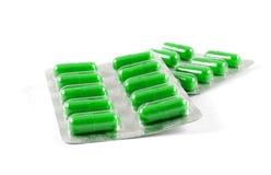 Antibiotic pills. Green antibiotic pills on white background stock images